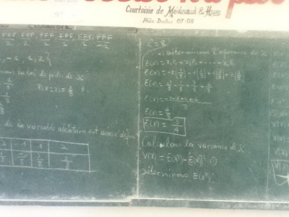 Advanced math on school blackboards.