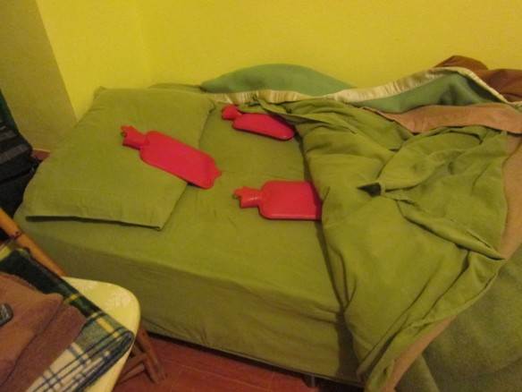 Hot water bottles keep Ruben's bed nice and toasty.