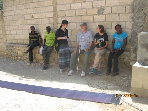 From right to left: Jeanide, Sora, Shuyan, Herodion, and the school gatekeeper.  Solar panel stretched out at our feet.