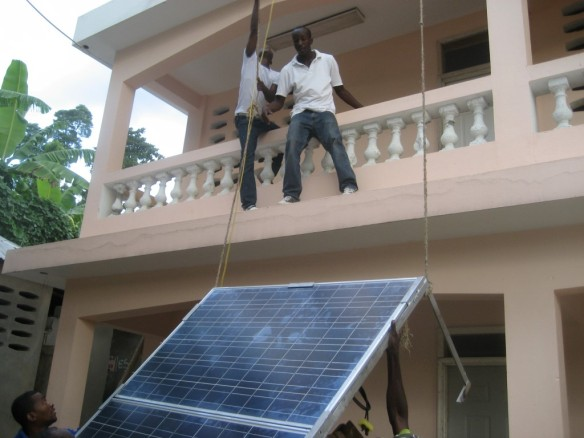 Hoisting up the solar panels