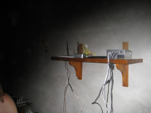 We constructed a shelf to keep the boxes with blinking lights out of the reach of kids.
